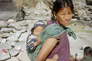 English: A Nepalese woman and her infant child.