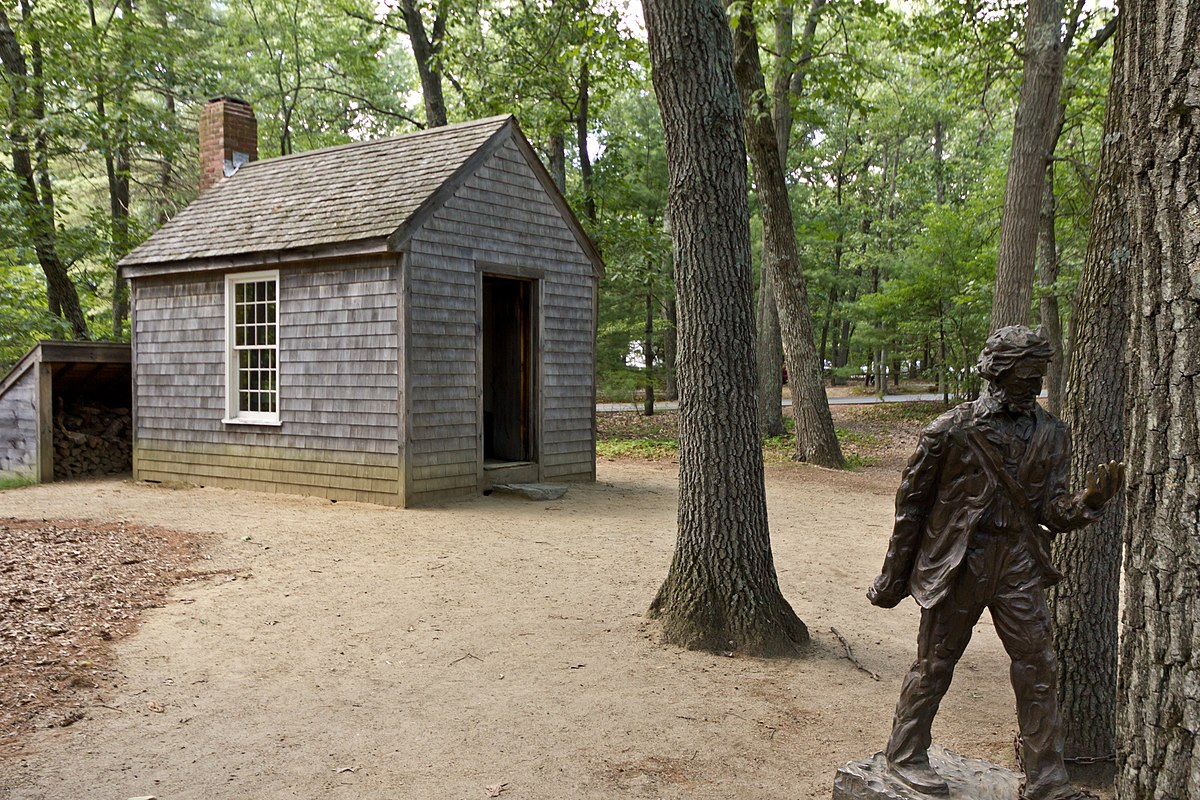 Replica of Thoreau's cabin near Walden Pond and his statue.jpg