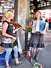 Two buskers in Seattle, Washington, with a vio...
