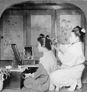English: The hairdresser making a call, Japan,...