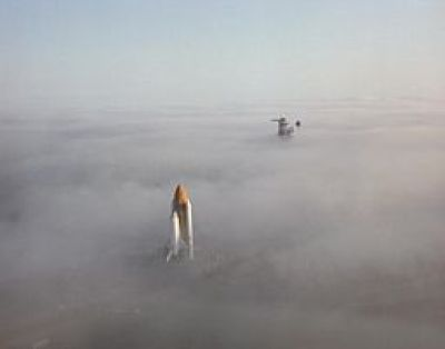 Space Shuttle Challenger moving through fog