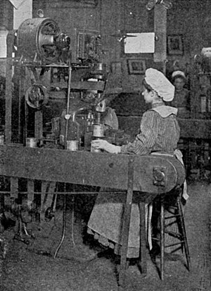 Female worker in an H. J. Heinz can factory cr...