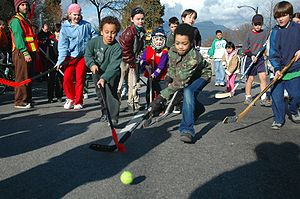Children playing street hockey, Vancouver, Canada.