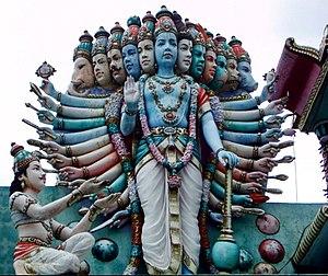 Lord Krishna displays his Vishvarupa (Universa...