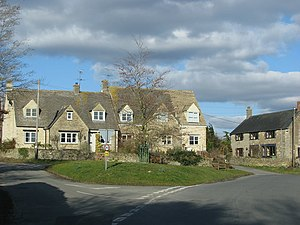 English: Road junction at the centre of Ampney...