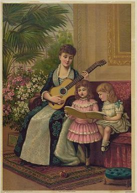 A mother plays the guitar while her two daught...