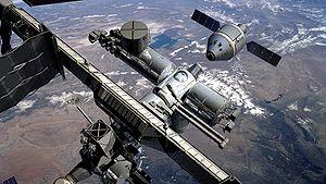 The CEV spacecraft docks to the International ...