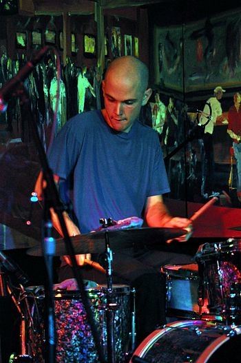 English: Drummer performing with saxophonist W...
