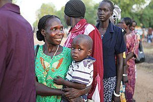Southern Sudanese line up to vote in Juba on J...