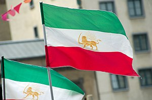 Iranian flags carried trough the streets of Br...