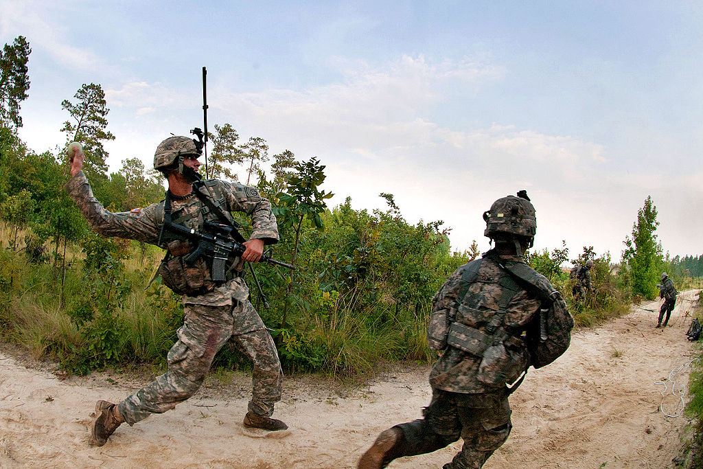 FileDefensegov News Photo 110721A3108M012  An Army combat engineer throws a smoke grenade