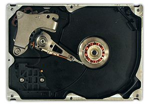 A hard disk drive with the platters and motor ...