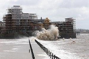 English: Knightstone Island in summer storm. A...