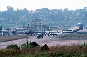 Three USAF C-130 Hercules aircraft are parked ...