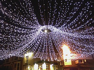 English: Full moon through Christmas lights in...