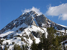 Red Slate Mountain (elevation 13,156 ft or 4,010 m) is still covered with snow in June.