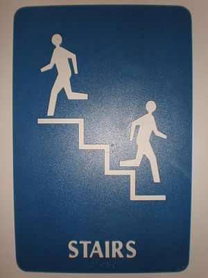 Stairs sign with braille at an office building...