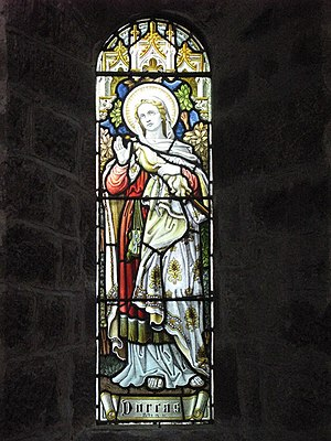 English: Dorcas Stained glass window in St. Jo...