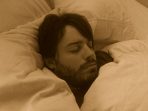 English: Man with beard sleeping.
