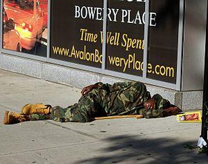 English: A man sleeping on the street of The B...