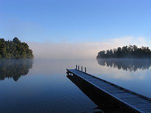 Morning mist on Lake Mapourika, New Zealand.