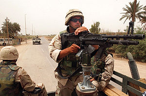 A Seabee maintains security by manning an M60 ...