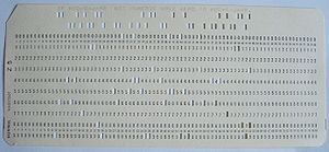 An actual punch card with a line of COBOL prog...