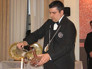 A Sommelier decanting and serving wine