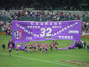 Fremantle players enter Subiaco Oval, by runni...
