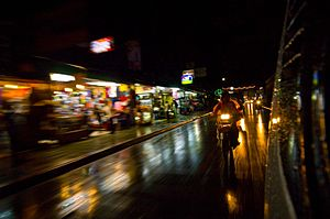 Driving down a street in Patong at night from ...