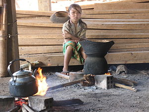 Girl next to cooking fire in Ratanakiri, Cambodia