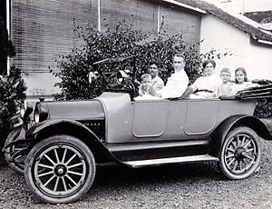 Portrait of a family with driver in a car