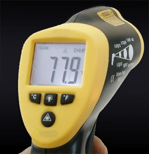 A handheld infrared thermometer of the type us...