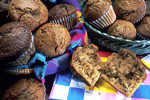 2 wicker baskets full of muffins sit on a blue...