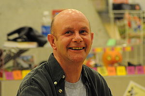 English: Nick Hornby signing books at Central ...