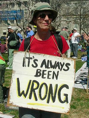 Protest holds sign at March 20, 2010 anti-war ...