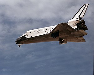 Atlantis deploys the landing gear before landi...