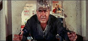 Jonathan Winters crashes through a wall