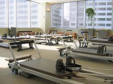 A group of Stott Pilates Reformers at the Toronto Corporate Training Center.