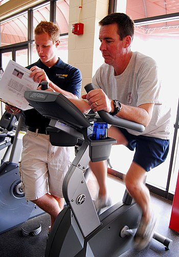 US Navy 090205-N-2183K-027 Cmdr. Robert Chase performs a cardio-vascular workout under the supervision of his advisor Rusty Early at Admiral Prout Field House