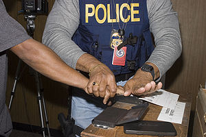 Police officer (U.S.) taking fingerprints