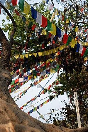 "English: Prayer flags and an inscription ""..."