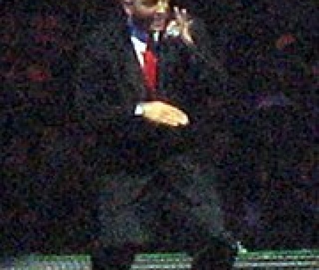 Eminem Onstage With Blond Hair And Wearing A Suit