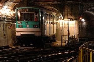 A MF 67 train of the Paris Métro near the Plac...