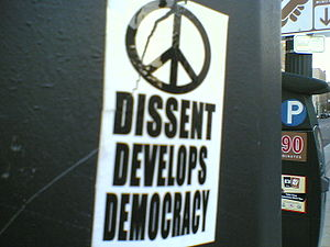 "Sticker advocating dissent: ""dissent deve..."