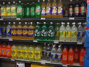 Soft drinks on shelves in a Woolworths superma...