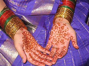 Indian bride's hands with mehndi