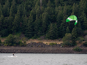 A man kitesurfing on the Columbia River Gorge ...