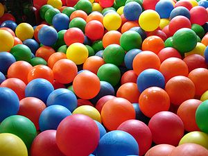 Multi-coloured plastic balls, as seen from a c...