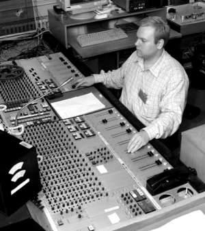 An audio engineer at an audio console.